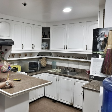 The look of the existing kitchen. Enclosed with an outdated feel.